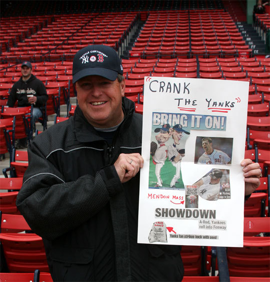 Mendon police officer Phil Dunlavey brings a new sign to every game he attends. He's been rooting for the Red Sox for more than four decades.