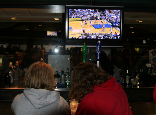 With the game well in hand thanks to Josh Beckett's dominance, some fans settled into the bar area behind the EMC Club to watch Game 3 of the NBA Finals between the Lakers and Magic.