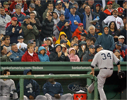 Red Sox fans let Yankees starter AJ Burnett (2 2/3 IP, 5 H, 5 R, 5 BB, 1 K) have it as he leaves the field.