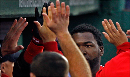 Teammates congratulate David Ortiz in the dugout after the slugger's two-run home run in the second inning.
