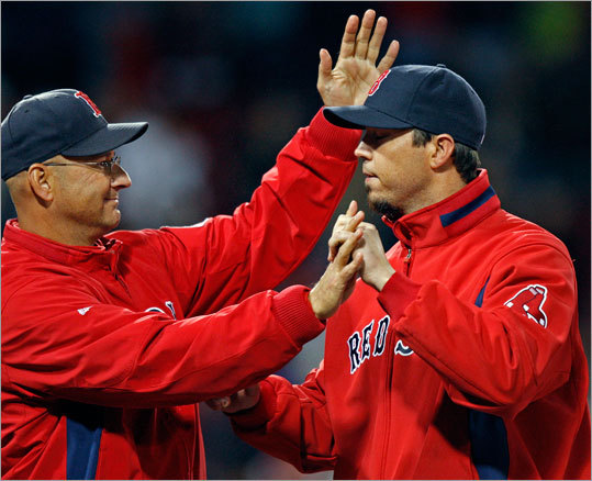 Red Sox manager Terry Francona (left) congratulates starter Josh Beckett after the game.