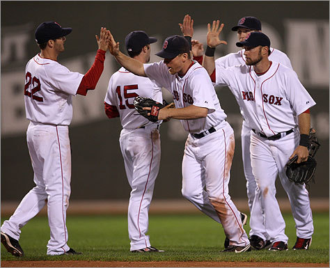 J.D. Drew (center) celebrated with the team after their 6-5 win over the Yankees.