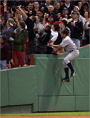 Johnny Damon scaled the left field wall for a foul ball in the second.