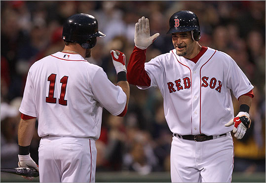 Mike Lowell (right) was congratulated by Mark Kotsay after hitting a solo home run in the third inning.
