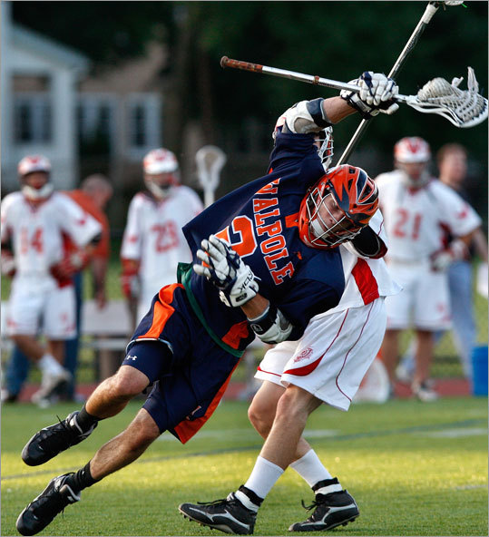 Walpole's Ryan Izzo (2) cuts to the net for a first-half goal.