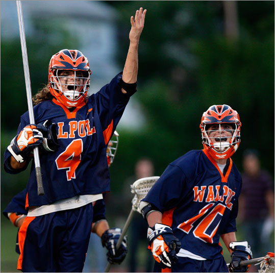 Walpole's Michael Connors (4) and Connor Whittemore (10) celebrate after a goal that put Walpole on top, 12-4, late in the first half.
