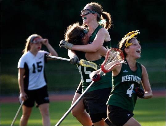 Westwood's Kelly Rich (5) and Erica Nangeroni celebrate as the time expired.
