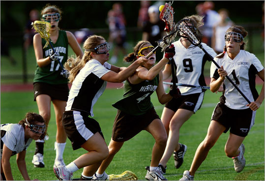 Westwood's Sarah Biron (4) battles through the Longmeadow defense.