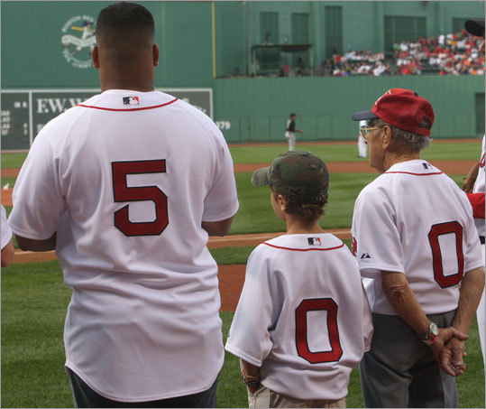 First pitch ceremonies celebrating Fenway's 500th consecutive sellout featured Staff Sgt. Julio Feliciano (left) who was joined by ten year old Walker Stressenger (center), and hundred year old Roger Gentilhomme.