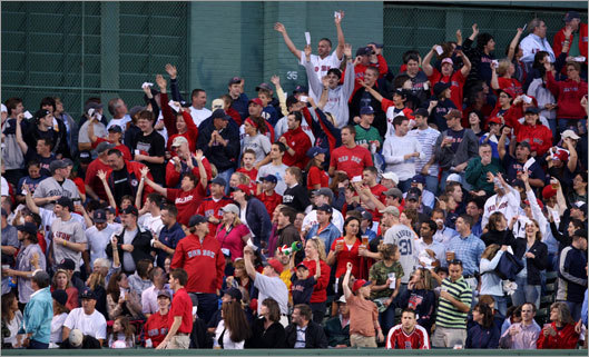 Fans in center field cheered after the announcement of coupons for free hot dogs as part of Fenway's 500th consecutive game sellout celebration.