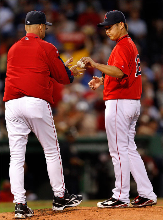 Daisuke Matsuzaka handed the ball manager Terry Francona in the fifth inning.