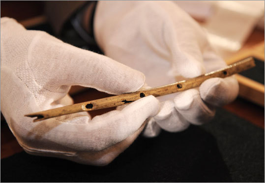 Professor Nicholas Conard of the University in Tuebingen shows a flute during a press conference in Tuebingen, southern Germany, on Wednesday.The thin bird-bone flute carved some 35,000 years ago and unearthed in a German cave is the oldest handcrafted musical instrument yet discovered.