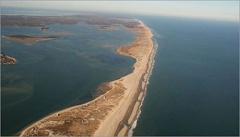 This photo of the barrier beach in Chatham was taken in 2006, before the ocean cut through. The five remaining First Village camps were visible in the lower portion of the photo. Read the article by the Boston Globe's Brian MacQuarrie