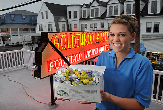 Abby Bourbon, 17, of North Berwick, Maine, displays a box of saltwater taffy outside The Goldenrod, the York establishment where she works.