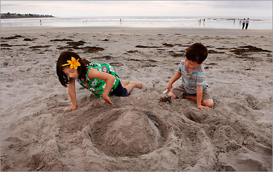 Ava, 5, and Owen, 3, have grand designs for their pyramid on Long Sands Beach in York, Maine.