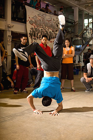 A male break dancer, known as a B-Boy, worked on his routine before the show.