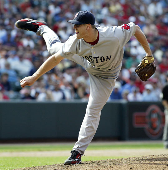 Red Sox relief pitcher Jonathan Papelbon follows through on his pitching delivery against the Baltimore Orioles in the 11th inning. Papelbon recorded his 20th save of the season in the Red Sox win, and also set a Red Sox record for most career saves by a relief pitcher in club history.