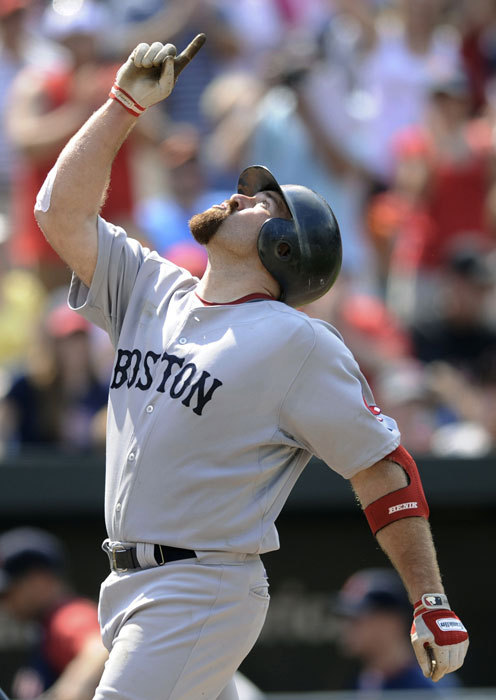 Kevin Youkilis celebrates his two-run home run against the Orioles during the ninth inning that brought the Sox to within two runs of Baltimore.