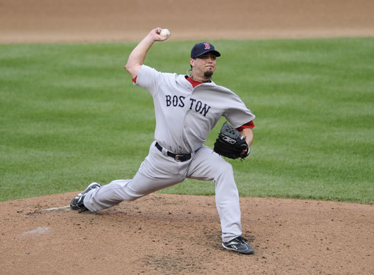 Red Sox starter Josh Beckett struggled early but settled down after giving up a home run to Baltimore's Ty Wigginton in the fourth inning.