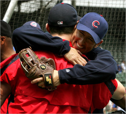 Garciaparra hugs his old teammate Trot Nixon as the Sox and Cubs warmed up before a game in Chicago on June 10, 2005, even though the injured Garciaparra didn't play.