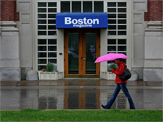 A pedestrian walks by the entrance to the Boston Magazine offices at the Christian Science Plaza in Boston.