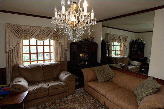 The first floor rooms — a living room, dining room and study — have crown molding and darker hardwood floors.