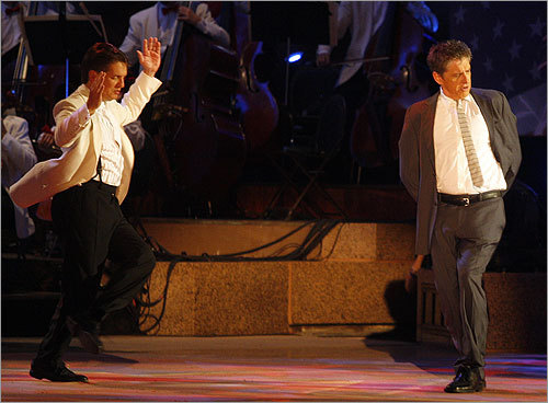 Keith Lockhart, conductor of the Boston Pops, and Craig Ferguson, of CBS's 'The Late Late Show with Craig Ferguson,' step danced during the Boston Pops Fireworks Spectacular on the Esplanade.