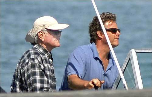 Senator Kennedy (left) spent the afternoon of May 25 on a powerboat with his family and friends watching the final leg of the 38th annual Figawi race from Nantucket to Hyannis. Kennedy, left with his son Edward M. Kennedy Jr., sat out both legs of the race.