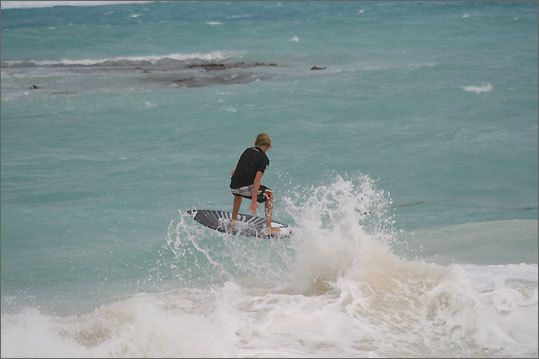 Catching a ride on the summer surf.