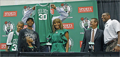 Wallace had some fun on the podium, holding his jersey over his face, while he was surrounded by his family: sons (from left) Nazir,12, and Ishmiel,13, his daughter Rashiyah, 5, and his wife, Fatima. Celtics president of basketball operations Danny Ainge and head coach Doc Rivers looked on. Read the Boston Globe article Welcoming committee Read the Bob Ryan column Winning at home has new meaning