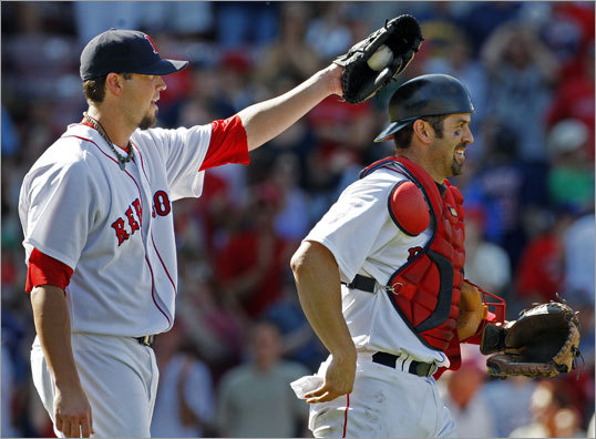Josh Beckett (left) and Jason Varitek celebrated after Beckett needed just 94 pitches to shut out the Royals on three hits.