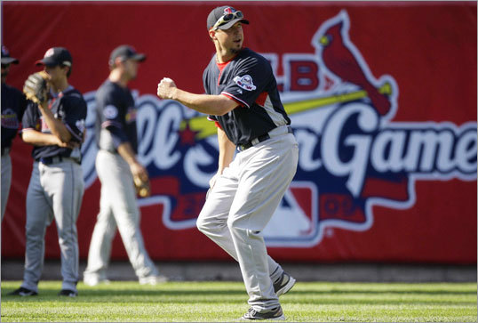 Red Sox pitcher Josh Beckett worked out in the outfield in St. Louis before the start of Monday's MLB All-Star Game festivities.