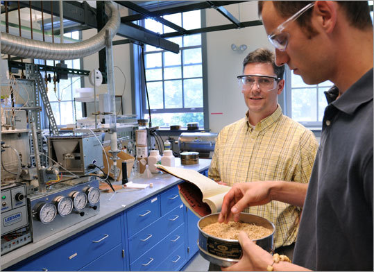 Umass-Amherst professor George Huber (left) and student Torren Carlson work at a gasoline-producing reactor.