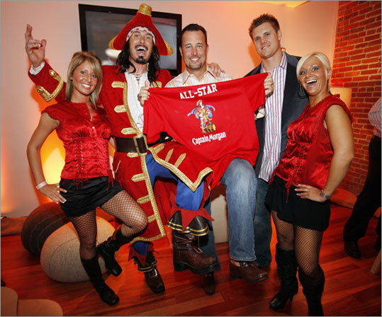 In this photograph taken for Captain Morgan, Captain Morgan and the Morganettes present Red Sox pitchers Tim Wakefield (center) and Jonathan Papelbon showing off their Captain Morgan All-Star jerseys at the Ryan Howard Foundation All-Star bash on Monday.