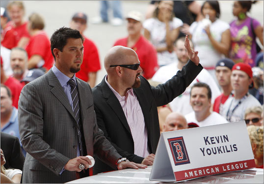 Josh Beckett (left) and Kevin Youkilis waved to spectators from the back of a car during the parade.