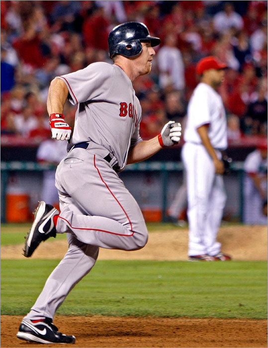 Looking for an under-publicized weakness on the 2009 Sox? So far, the Sox rank 13th among the 14 American League teams (and 25th among the 30 major league clubs) in on-base percentage from their leadoff hitter (.313). That fact recently inspired manager Terry Francona to settle on new leadoff man J.D. Drew (pictured), whom Francona seems inclined to keep atop his lineup. So far, Drew has posted a .352 on-base percentage as the leadoff man, a number that would place the Sox ninth in baseball in on-base percentage from the top spot. That's a nice improvement from the overall team number of .313. The obvious problem is the Red Sox are sacrificing some middle-of-the-order power to do so, something that makes the health of Lowell (or the acquisition of another bat) all the more critical.