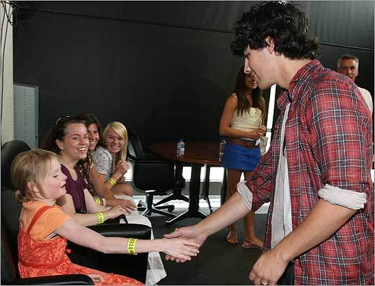 Joe Jonas greets fans at Logan Airport on Friday before the Jonas Brothers' concert at TD Garden.