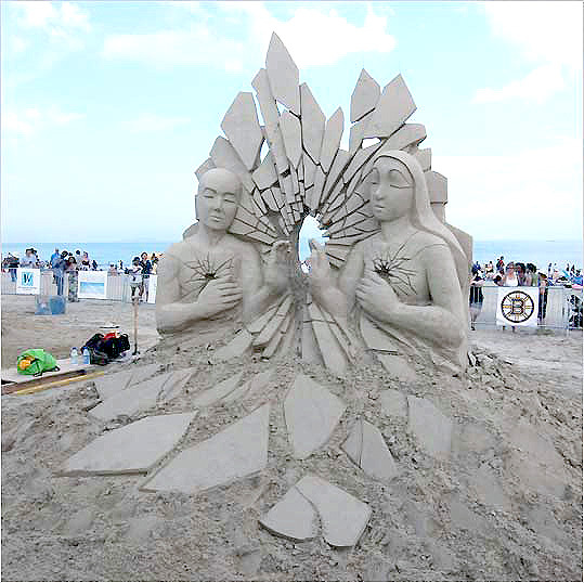 And the official 2009 winner is ... 'Mirror' Sue McGrew has been carving for six years and has competed all over the United States and Europe. She took top honors in the North American Sand Sculpting Competition at Virginia Beach in 2008. McGrew says carving is 'dangerously addictive.' Official standings: Third place: Face Plant Second place: Ouroboros People's choice award: Mirror All of the entries will be on display until the end of the month, weather permitting.