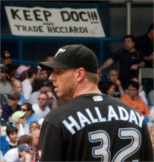 A fan holds up a sign supporting Toronto ace Roy Halladay.