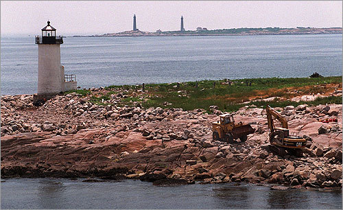The Straitsmouth Island Lighthouse (in the foreground) was built in 1835. Behind it, the twin lighthouses on Thacher Island, which were erected in 1771.