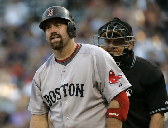 The Red Sox' offense struggled from the start as Kevin Youkilis strikes out against Rangers starter Tommy Hunter in the first inning Tuesday night.
