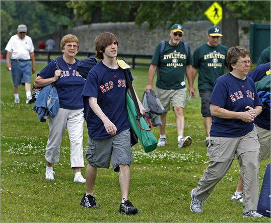 At 11 a.m., 2 1/2 hours before the start of the ceremony, fans dressed in Red Sox shirts for Jim Rice and Oakland A's shirts for Rickey Henderson were streaming onto the grounds to claim a spot on the grass to watch the ceremony.