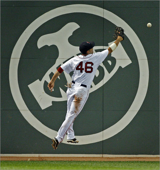Jacoby Ellsbury misplays a carom off the wall by Scott Hairston in the eighth inning which falls in for a triple ...
