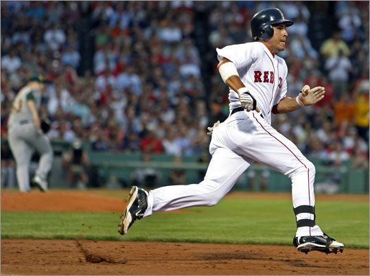 Jacoby Ellsbury puts it in high gear as he rounds first base on his way to a third-inning triple.