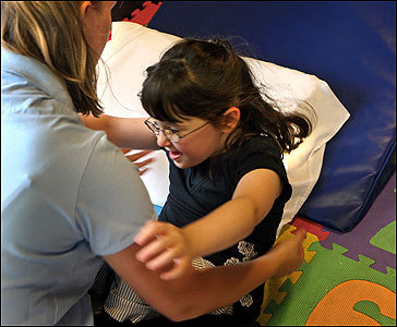 Jordan Robie, 5, worked on situps with the encouragement of her physical therapist, Jessica Bartha, at Jump Start in Natick.