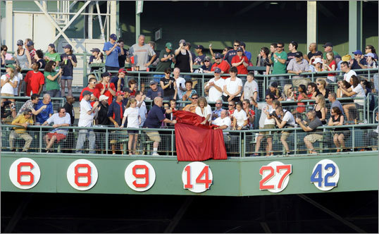 The Red Sox made Rice the seventh player to have his number retired by the team, honoring the new Hall of Famer in a ceremony before Tuesday's game with the A's. Here, Rice's No.14 was unveiled on the right field facade at Fenway Park.