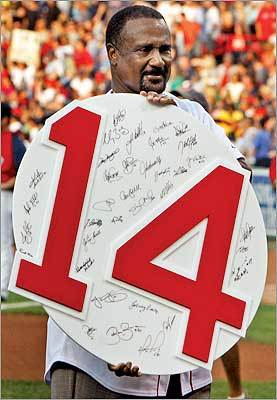 Rice held up his number 14, which was signed by the current Red Sox team.