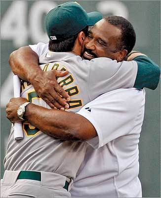 When Rice came onto the field from the left field corner door, he stopped and hugged former Red Sox shortstop and current A's utility man Nomar Garciaparra.