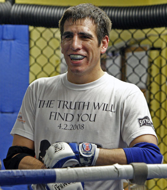 Kenny Florian flashes a wide smile while training at the Sitydtong USA Gym in Somerville. Florian is preparing for the UFC's Lightweight Championship bout as part of UFC 101: Declaration, which will take place on August 8 in Philadelphia.