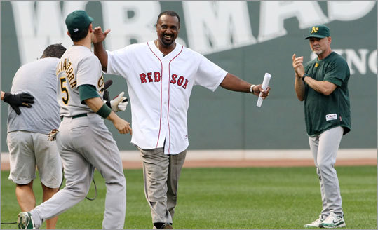 Oakland's Nomar Garicaparra rushes out to embrace Jim Rice as he heads in from left field.